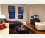 STOCK EXCHANGE...WALL STREET..FREEDOM TOWER ..SLEEK 2BR Huge Walk In Closet___Free Gym,Broadway,Steps from the Subway